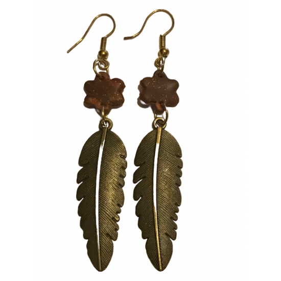 Handmade dangling earrings that combine elements of bronze and clay in brown color.X12